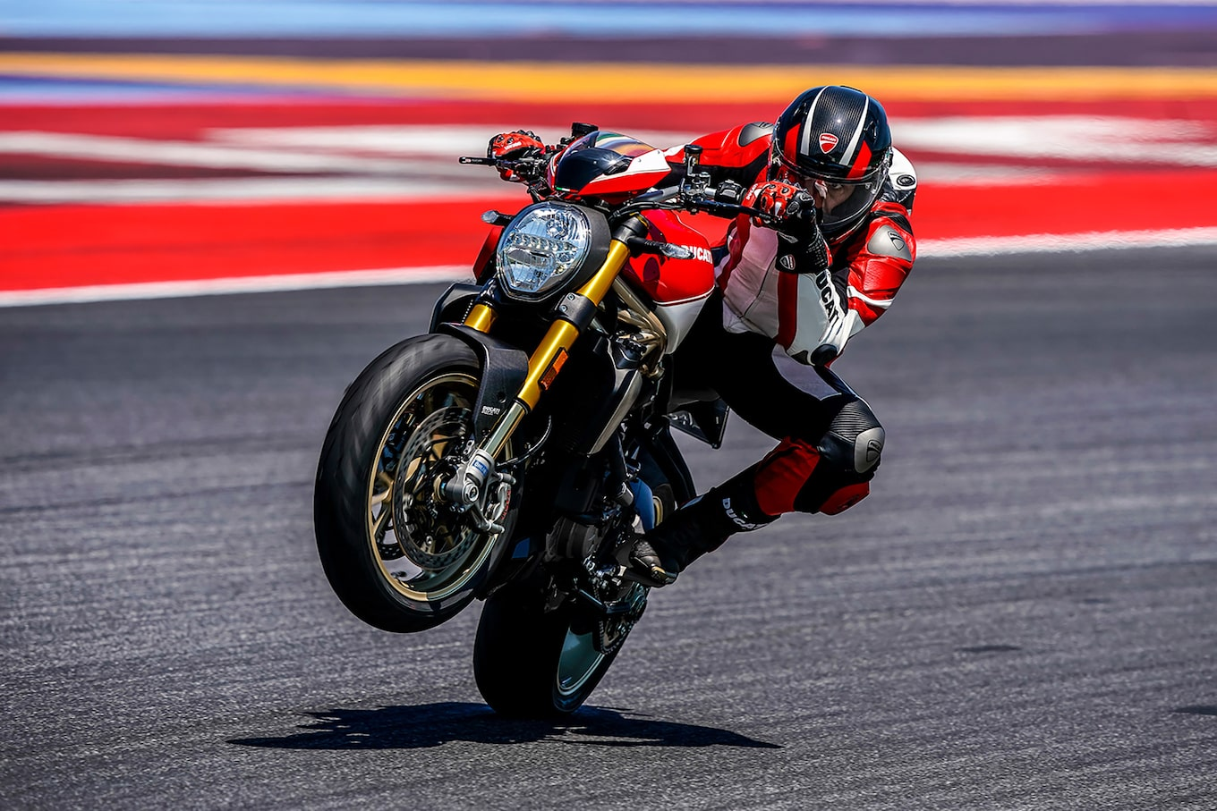 alex-farinelli-sony-alpha-9-motorcyclist-pops-a-wheelie-on-race-track