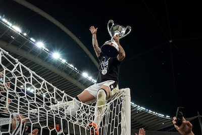 menelaos-myrillas-sony-alpha-9-greek-cup-final-winner-holds-trophy-aloft