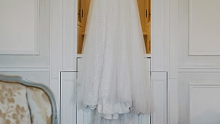 sina-demiral-sony-alpha-99II-bridal-gown-hanging-over-door